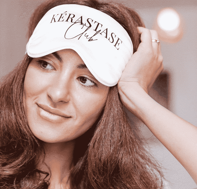 brown haired woman with a kerastase sleeping mask