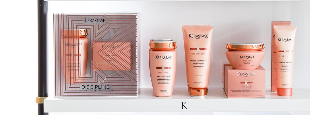 kerastase discipline products on a white shelf