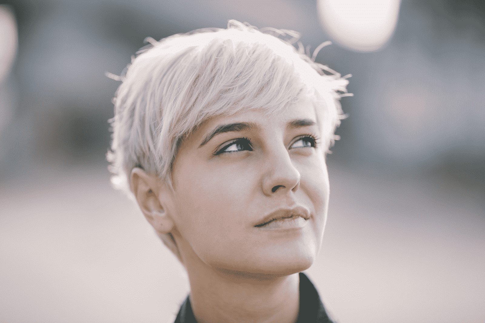 woman with pastel pixie cut looking to the side