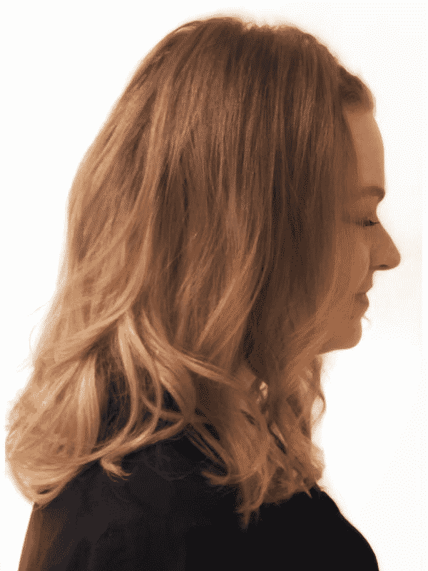 profile of a long haired woman with eyes closed