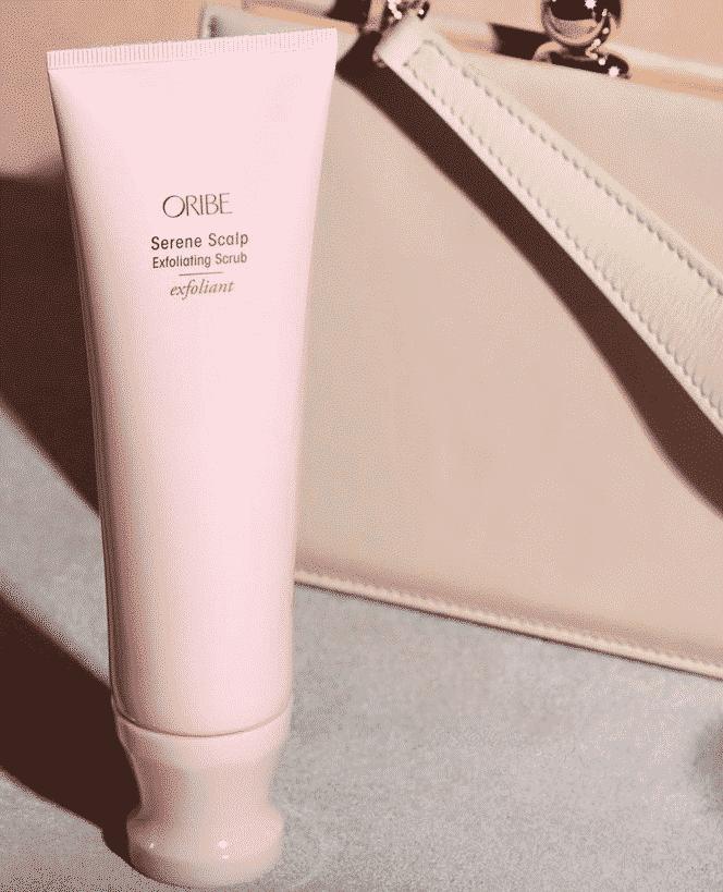 oribe serene scalp exfoliating scrub pastel pink beauty product bottle