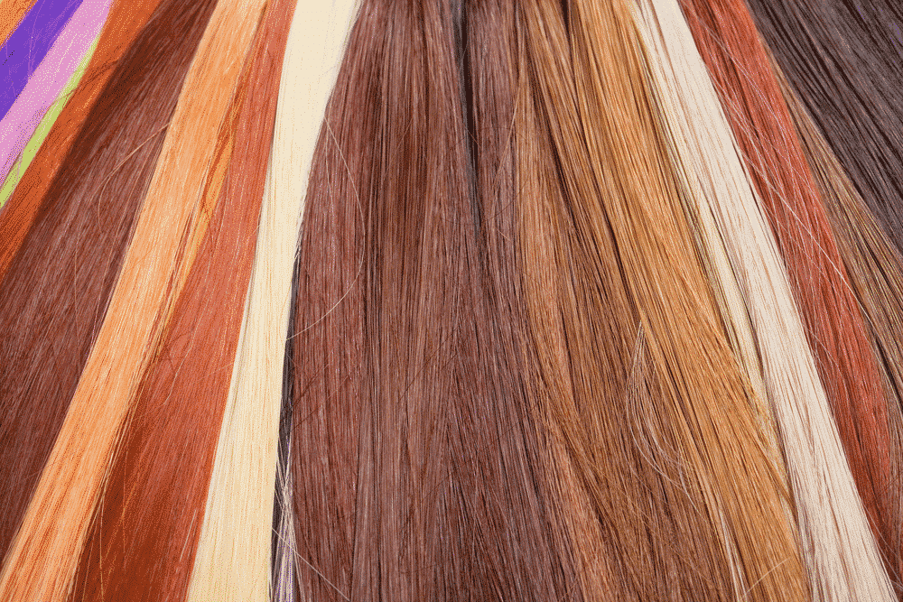 rows of differently colored hair extensions