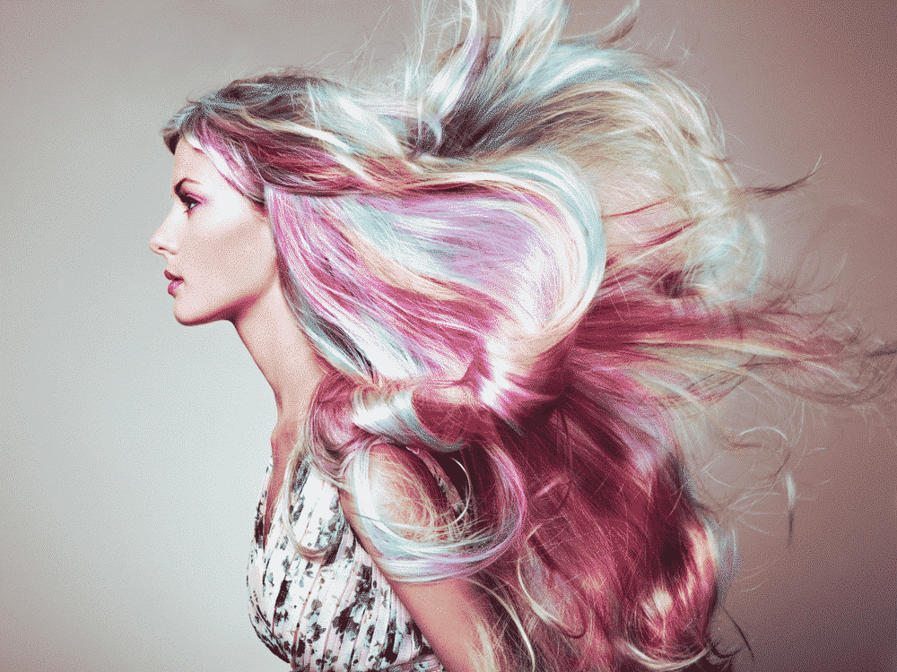 woman with long rainbow hair flowing standing sideways