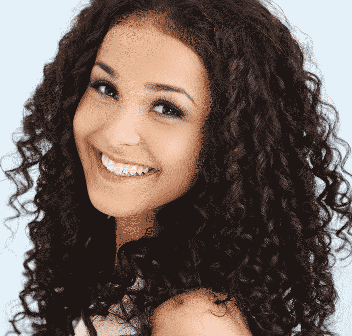 smiling woman with curly brown locks