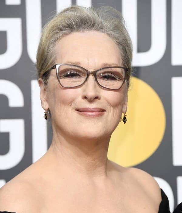 Meryl streep grey hair golden globes gala with glasses and black dress